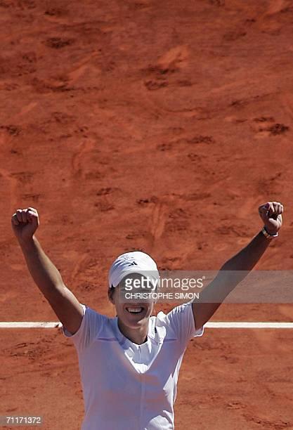 Belgian Justine HeninHardenne celebrates after defeating Russian Svetlana Kuznetsova during the French tennis Open finals at Roland Garros in Paris...