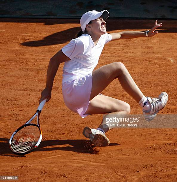 Belgian Justine HeninHardenne falls during her match against Belgian Kim Clijsters on the semifinals of the French tennis Open at Roland Garros in...