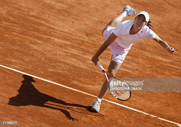 Belgian Justine HeninHardenne hits a return to Belgian Kim Clijsters during the semi finals of the French tennis Open at Roland Garros in Paris 08...