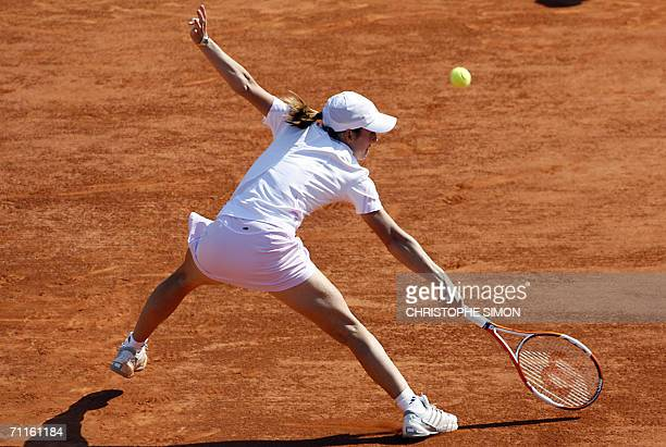 Belgian Justine HeninHardenne hits a return to Belgian Kim Clijsters during the semifinals of the French tennis Open at Roland Garros in Paris 08...