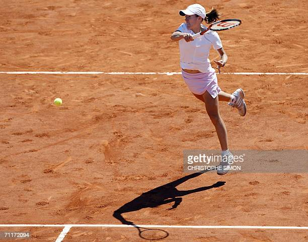 Belgian Justine HeninHardenne hits a shot to Russian Svetlana Kuznetsova during the French tennis Open finals at Roland Garros in Paris 10 June 2006...