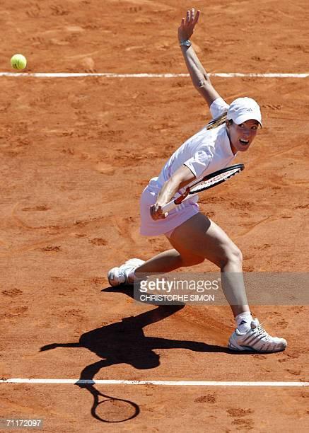 Belgian Justine HeninHardenne hits a shot to Russian Svetlana Kuznetsova during the French tennis Open final at Roland Garros in Paris 10 June 2006...