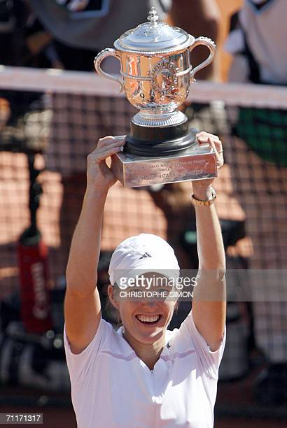 Belgian Justine HeninHardenne holds the trophy after winning against Russian Svetlana Kuznetsova during the French tennis Open final at Roland Garros...