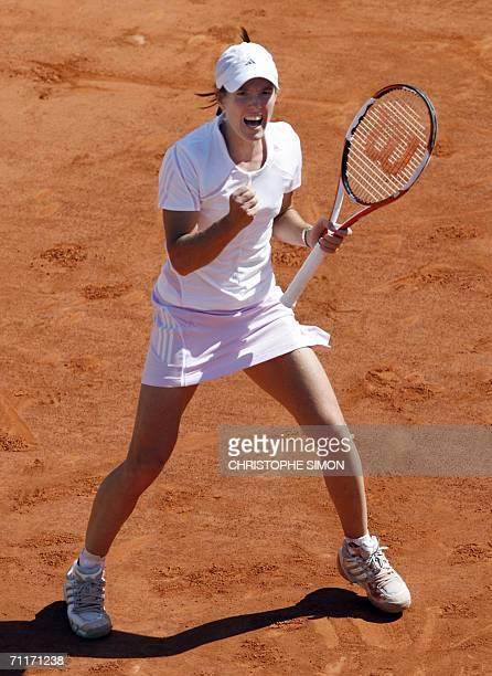 Belgian Justine HeninHardenne jubilates after winning a point against Russian Svetlana Kuznetsova during the French tennis Open final at Roland...