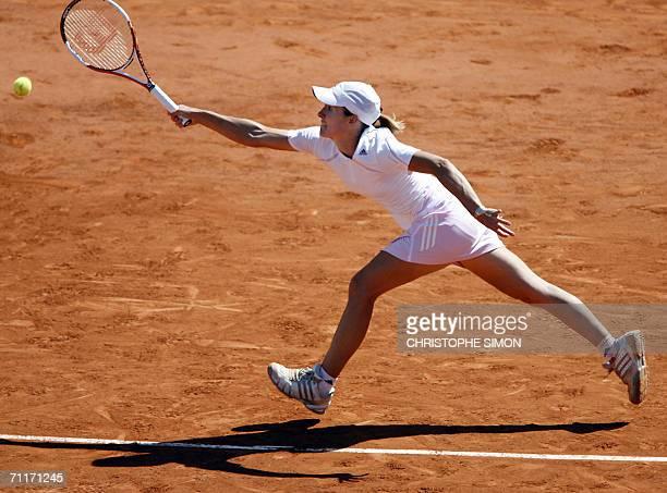 Belgian Justine HeninHardenne tries to return the ball to Russian Svetlana Kuznetsova during the French tennis Open final at Roland Garros in Paris...