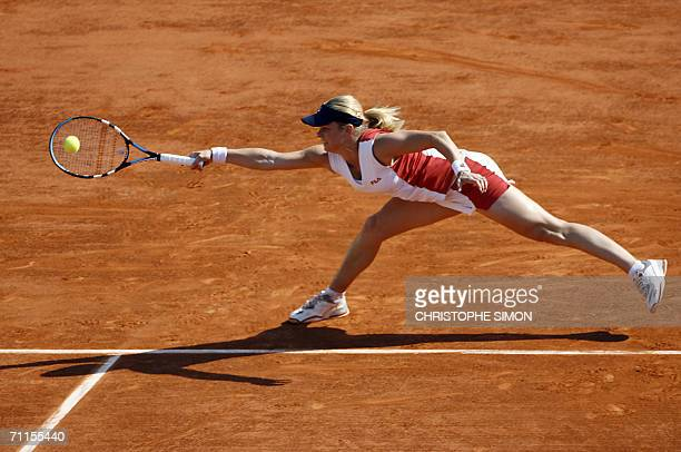 Belgian Kim Clijsters hits a shot to Belgian Justine HeninHardenne during the semifinals of the French tennis Open at Roland Garros in Paris 08 June...