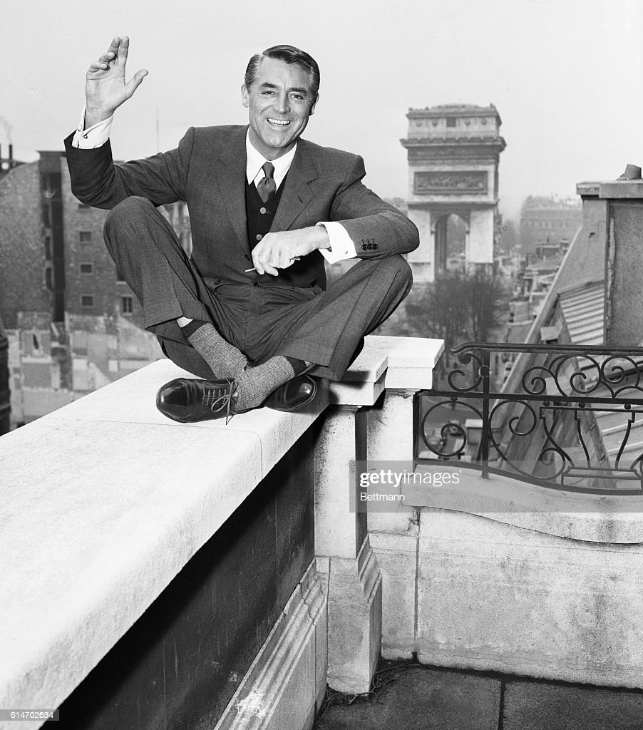 Actor Cary Grant on Balcony in Paris : News Photo