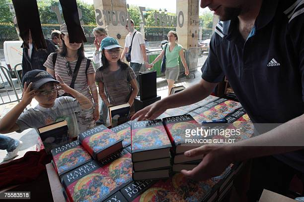 Children gather in front of a bookshop as a bookseller set up copies of Harry Potter And The Deathly Hallows 21 July 2007 in Paris The last book in...