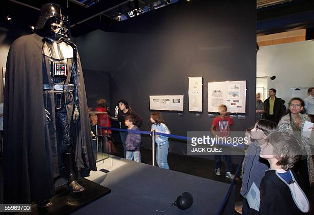 Children look at Dark Vador a character from the famous movie Star Wars by US director George Lucas during an exhibition at the Cite des Sciences 19...