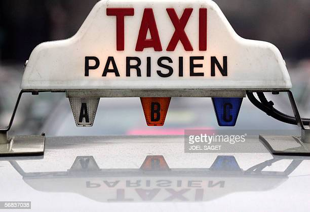Closeup of a Parisian Taxi sign as taxi drivers staged a protest rally on the streets of the French capital 13 February 2006 to oppose over fining by...