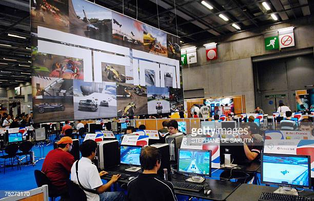 Competitors play video games on monitors during the final of the 5th edition of the Electronic Sports World Cup ESWC 2007 event 08 July 2007 in Paris...