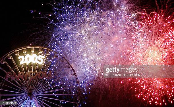 Fireworks light the sky over the Champs Elysees Avenue in Paris where thousands of people were celebrating the new year 01 January 2005 AFP PHOTO...