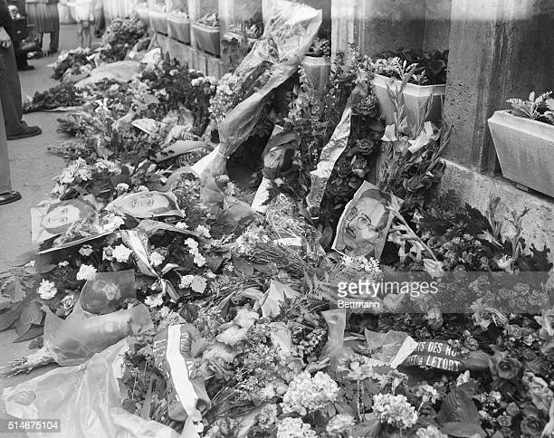 6/23/1953 Paris France Flowers for Rosenbergs in Paris Portraits of Ethel and Julius Rosenberg lie among the bouquets and wreaths of flowers laid by...