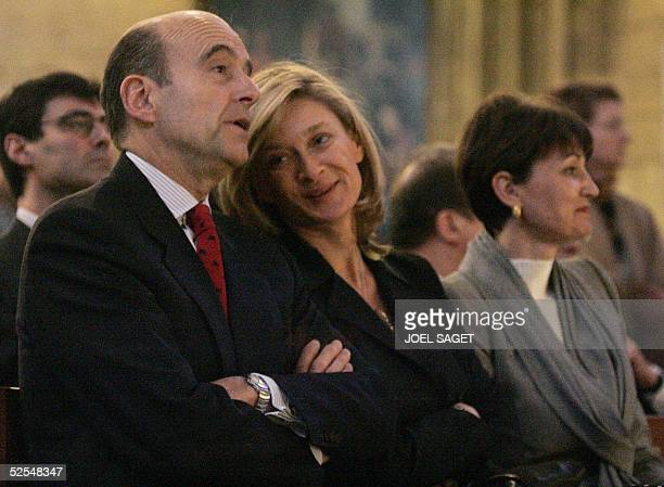 Former French Prime Minister Alain Juppe attends with Isabelle Barnier French Foreign Minister's wife and AnneMarie Raffarin French Prime Minister's...