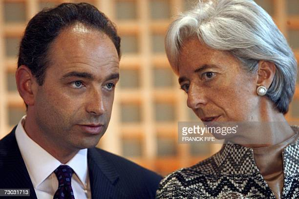 France's delegate ministers for the Budget and Administrative Reform JeanFrancois Cope and for Foreign Trade Christine Lagarde chats as minister of...