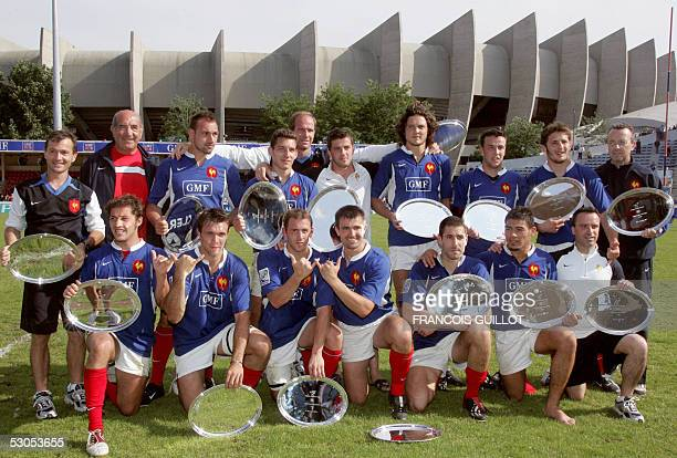 France's players hold trophies after winning the Paris leg of the IRB World Series rugby sevens final match France vs Fiji 11 June 2005 at the Jean...