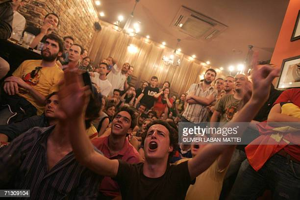French and Spain's football fans react in a bar in Paris, at the end of the World Cup 2006 football match Spain vs France at Hanover stadium,...