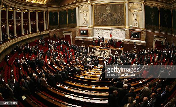 French deputies leave the National Assembly at the end of the opening session 26 June 2007 in Paris French lawmakers returned to the National...
