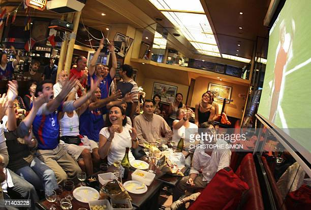 French football fans react in a bar in Paris as they watch the World Cup 2006 final football match between Italy and France played 09 July 2006 at...