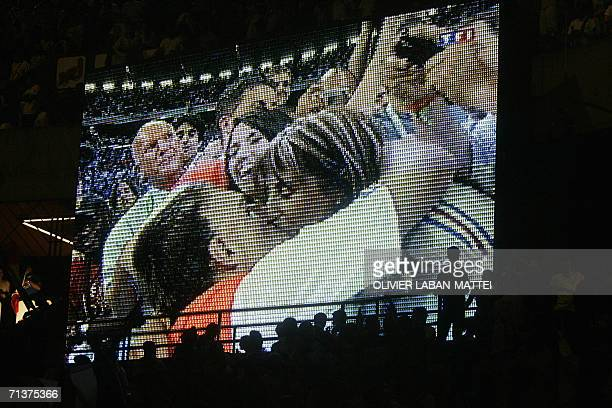 French football fans support their team at the Parc des Princes stadium in Paris as they watch the game on a giant screen showing the French football...