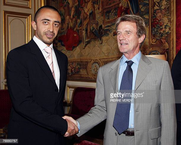 French Foreign Affairs Minister Bernard Kouchner shakes hands with his United Arabic Emirates counterpart Cheikh Abdallallah bin Zayed Al-Nahyan, 18...