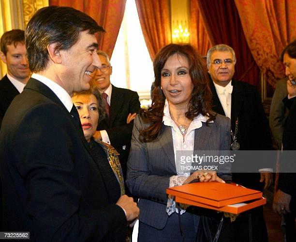French Foreign Minister Philippe DousteBlazy offers a gift to Argentinian President Nestor Kirchner's wife Senator Cristina Fernandez De Kirchner...