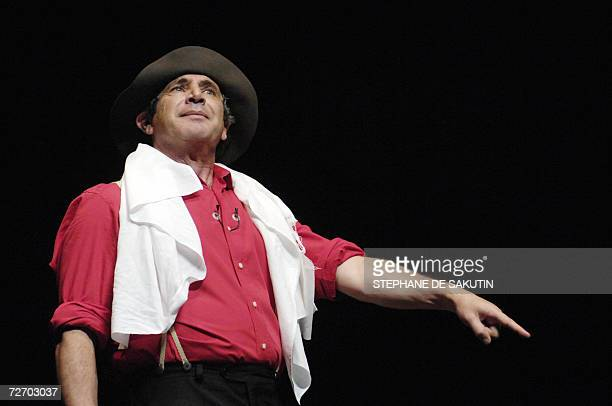 French humorist Michel Boujenah performs 02 December 2006 his new show Les nouveaux magnifiques on the stage of the Olympia theater in Paris The show...