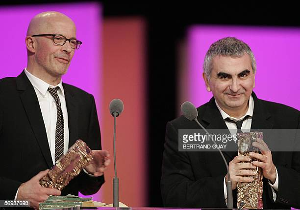 "French Jacques Audiard and French Tonino Benaquista and pose with the Best adaptation Award for ""De battre mon coeur s'est arrete"", 25 February 2006..."