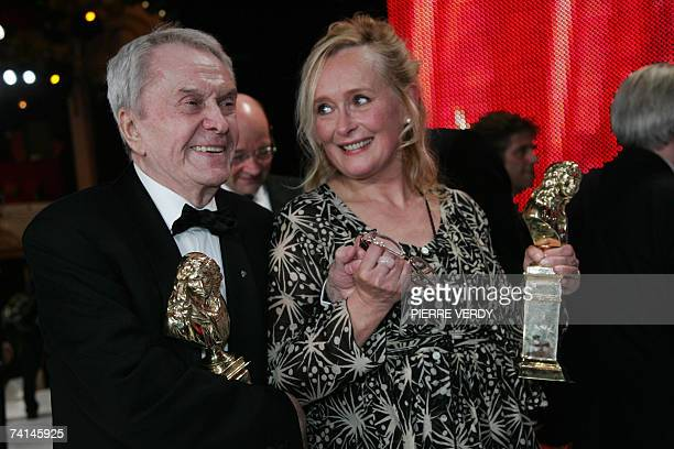 French legendary actors Robert Hirsch and Martine Chevallier awarded with best actor and best actress trophy hold their hands 14 May 2007 on the...