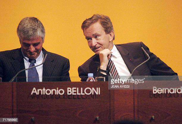French luxury products group LVMH CEO Bernard Arnault speaks with deputy chief executive officer Antonio Belloni during a press conference announcing...