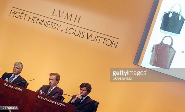 French luxury products group LVMH deputy chief executive officer Antonio Belloni CEO Bernard Arnault and Chief Financial Officer JeanJacques Guiony...