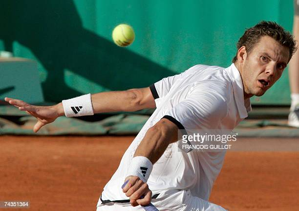 French player PaulHenri Mathieu eyes the ball from German player Florian Mayer during their French Tennis Open first round match at Roland Garros 29...