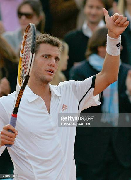 French player PaulHenri Mathieu shows a thumb up during a match against German player Florian Mayer during their French Tennis Open first round match...