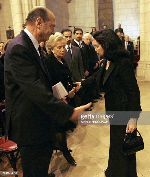 French president Jacques Chirac and his wife Bernadette give comfort to Rafiq Hariri's widow Nazek Hariri 14 February 2006 at the Notre Dame du Liban...