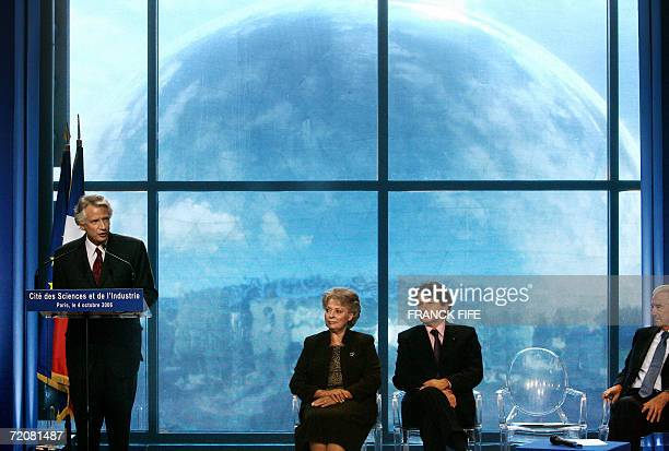 French Prime Minister Dominique de Villepin delivers a speech next to Minister for Ecology and Sustainable Development Nelly Olin Economy Minister...