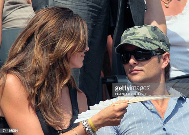 French singer David Hallyday and his wife Alexandra Pastor attend a match between Spanish players Rafael Nadal and Carlos Moya during their French...