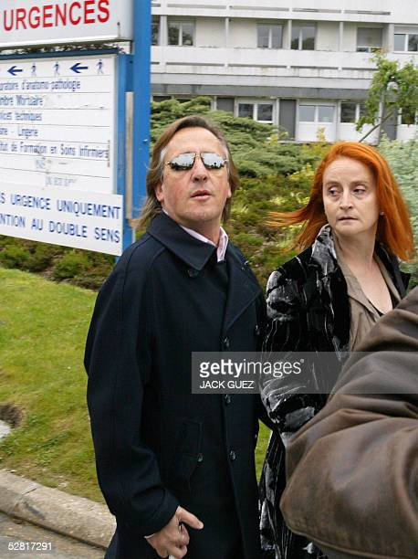 French singer Gilbert Montagne and his wife Nicole arrive at Ambroise Pare hospital 13 May 2005 in Paris after Eddie Barclay the most successful...