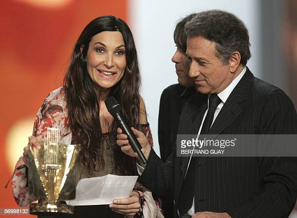 French singer Zazie gives a speech next to TV host Michel Drucker after winning the best musical/tour/concert of the year award during the 21st...
