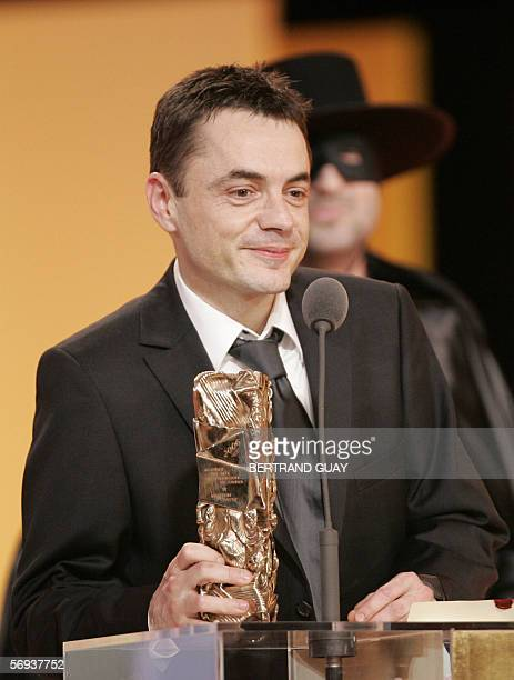 "French Stephane Fontaine poses with the Best picture Award for ""De battre mon coeur s'est arrete"", 25 February 2006 on the Theatre du Chatelet in..."