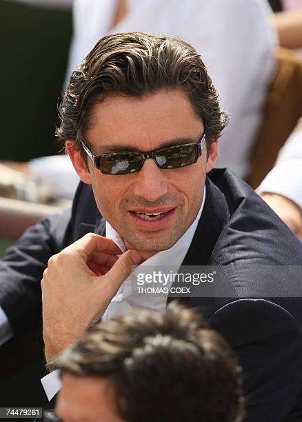 French TV channel TF1 number two Laurent Solly attends the French Tennis Open women singles final match between Belgian player Justine Henin and...