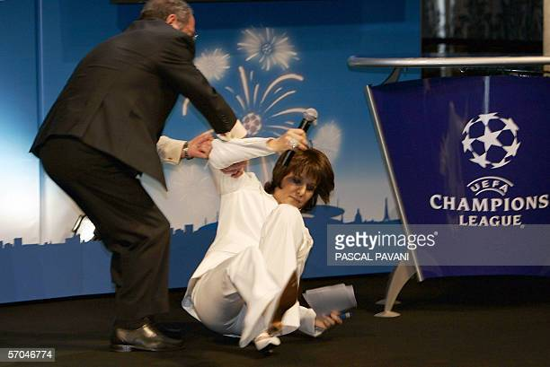 French TV host Carole Rousseau faints 10 March 2006 at Paris City hall during the draw of the quarterfinals of the European football Champions League...