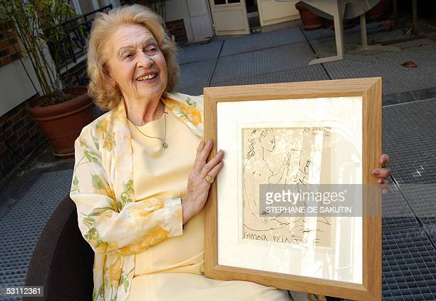 Genevieve Laporte 79yearsold holds a portrait of her made by Spnanish artist Pablo Picasso at Hotel Dassault 21 June 2005 in Paris Laporte who had a...