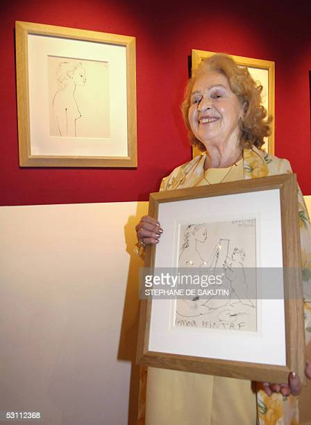 Genevieve Laporte 79yearsold holds a portrait of her made by Spanish artist Pablo Picasso at Hotel Dassault 21 June 2005 in Paris Laporte who had a...