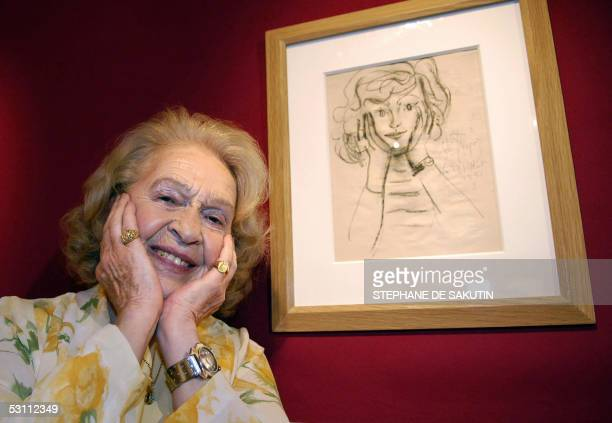 Genevieve Laporte 79yearsold poses next a portrait of her made by Spnanish artist Pablo Picasso at Hotel Dassault 21 June 2005 in Paris Laporte who...