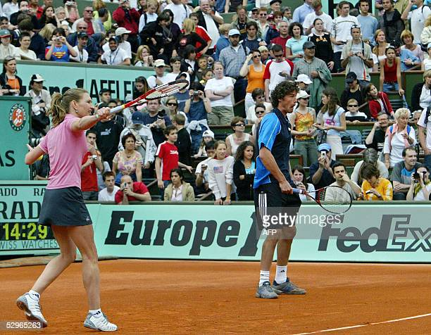 German Steffi Graf and Russian Marat Safin return the ball to Belgium Justine HeninHardenne and French Gilles Simon during their friendly double...
