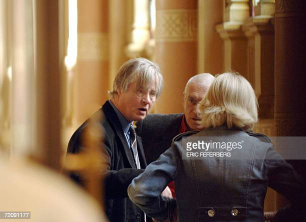 Guillaume Seznec's grandson Denis Le HerSeznec is seen speaking with two unidentified persons 05 October 2006 in Paris as the French Court of...
