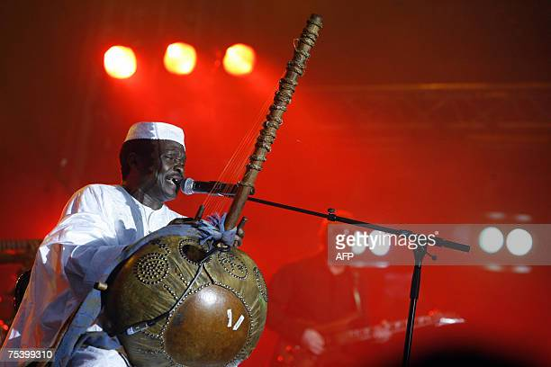 Guinean singer Mory Kante perfoms during a concert at Paris' Bastille square 13 July 2007 as part of the July 14 celebrations AFP PHOTO CLEMENS BILAN