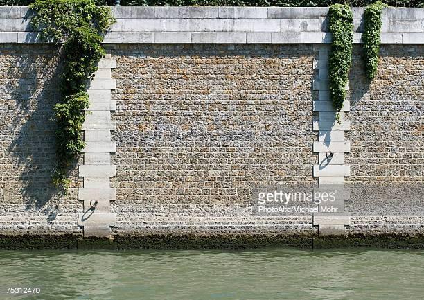 paris, france, ile de le cite, close-up of island wall - paris island stock photos and pictures
