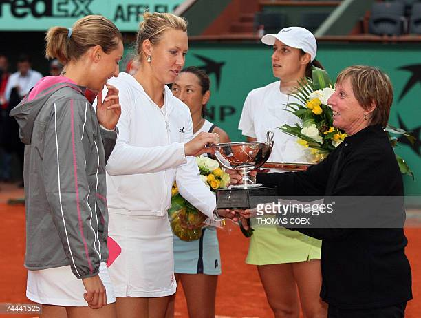 Italian player Mara Santangelo and Australian player Alicia Molik receive their trophy from French former tennis player Francoise Durr after winning...