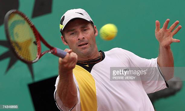 Italian player Stefano Galvani hits a backhand shot to Russian player Nikolay Davydenko during their French Tennis Open first round match at Roland...